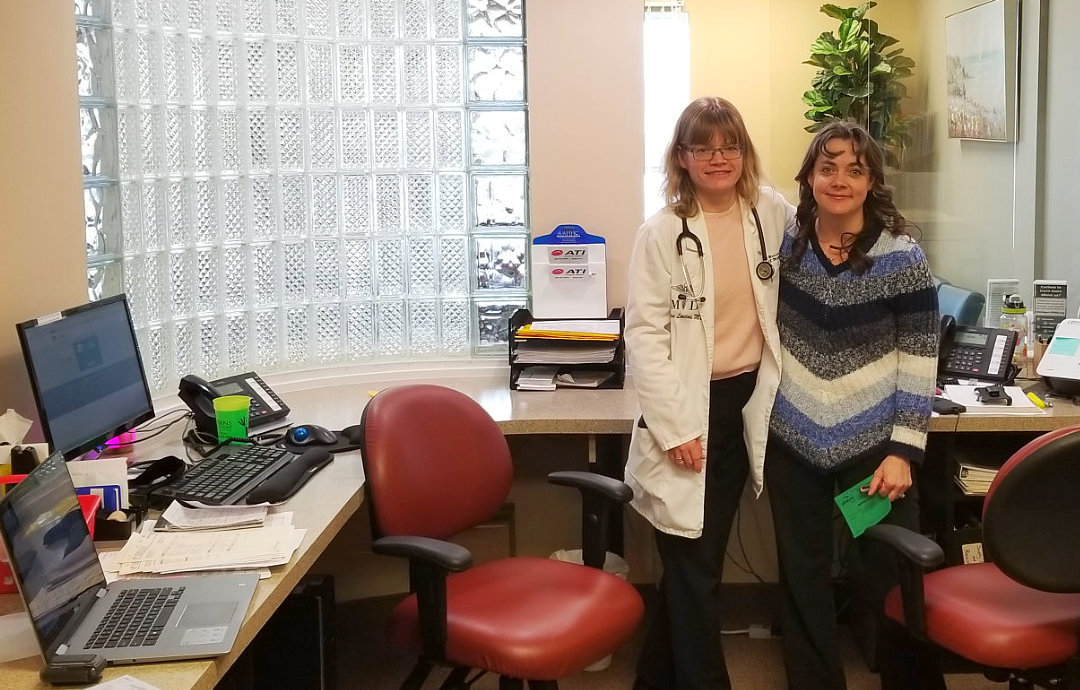 doctor with her patient smiling